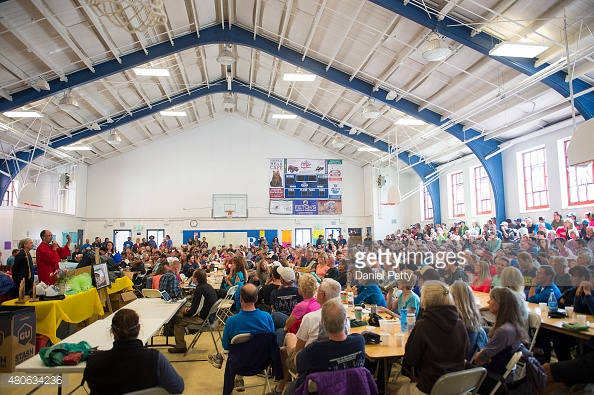 480634236-runners-crew-volunteers-and-staff-sit-in-the-gettyimages
